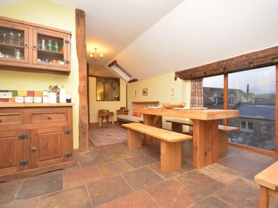 A sweet country kitchen leading to the dining area