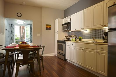 Kitchen is spacious, and fully equipped for cooking and relaxing.