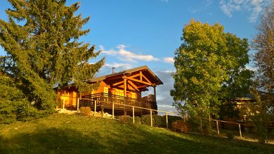 Photo for Cozy chalet Haut-Jura - Swimming pool on the estate - Terrace with open view