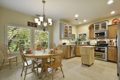 Kitchen and Dining - The formal dining room has a large oak table for family style meals and seats 10 comfortably.