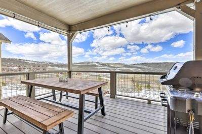 This vacation rental boasts a covered deck with a gas grill.