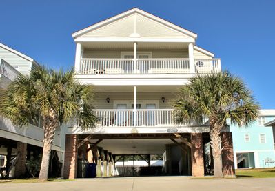 Front Exterior of Home.  Two Ocean-facing porches.  Parking, private pool