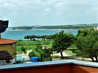 Photo for Blue Bay apartment - top floor property with sea views - 200m from beach