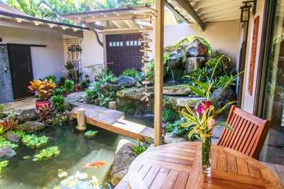 Oasis is a unique tropical escape, built around a waterfall garden courtyard