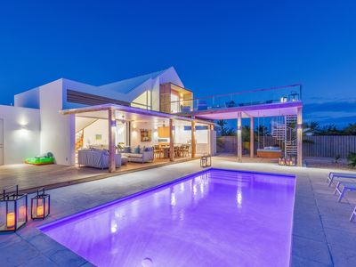 Photo for Enjoy sunset on the large deck! BRAND NEW luxury villa in gated enclave.