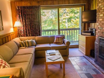 Photo for This great little two bedroom/one bath condo has an oversized living area for everyone to enjoy hanging out in front of the gas fireplace.  Take the shuttle to the mountain and ski home.  Killington's great restaurants and night clubs are really close by too.