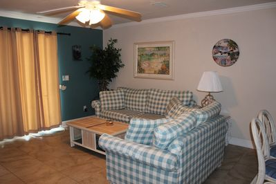View of living room from dining area, spacious room, slider leads to open deck