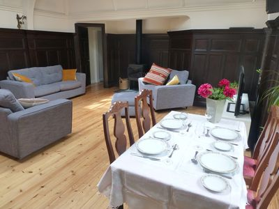The dining area with living area in the background