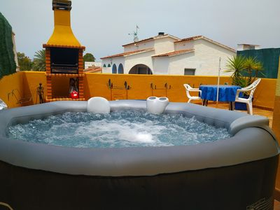 Photo for EMPURIABRAVA apartment with terrace and jacuzzi