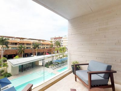 Photo for NEW LISTING! Modern condo w/ shared pools, & sundeck - walk to the beach!