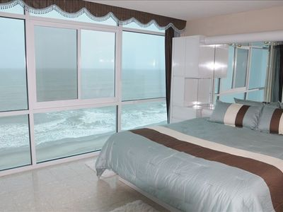 Photo for Ocean Front Condo Breathtaking balcony and bedroom Sunrise Views