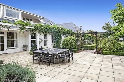 Large outdoor dining table and access to manicured gardens