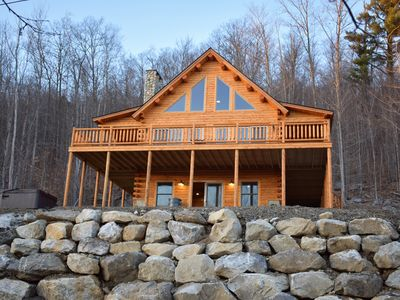 Photo for Spring Skiing at it's best. Spacious log home sleeps 12 and an 8 person hot tub