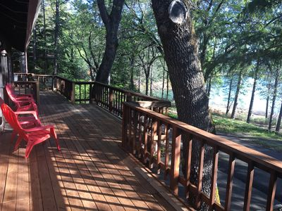 Photo for Lake side house with 1000 sq/ft of decking with unobstructed view of the water.