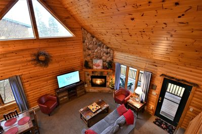 """Cute, cozy and comfortable main living area with a gas fireplace and a 55"""" TV!"""