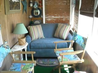 Enjoy the ocean breezes on the cozy porch. The over sized chair pulls out.
