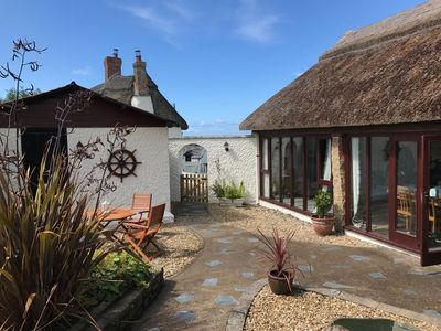 Photo for A charming and unique thatched barn with idyllic countryside views, near Bude
