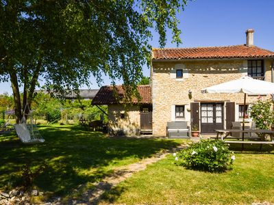 Photo for Natural stone home, nearby Chinon and Poitier, 10 km from a recreational lake.