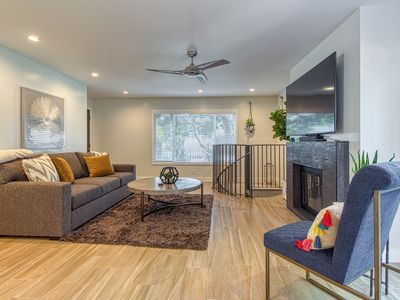 Photo for Contemporary condo w/ gas fireplace & large, enclosed patio - close to the beach