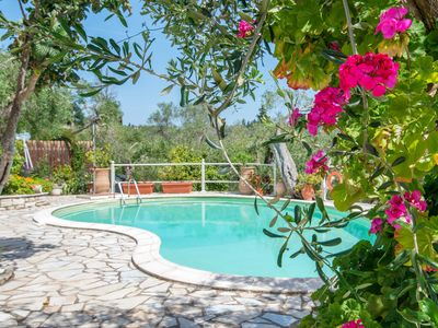 Photo for Villa with pool situated amongst the Olive Groves of Fanariotatika