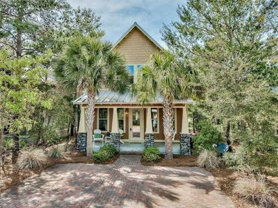 Photo for Beautiful Updated Beach Cottage! Minutes To The Beach and Gulf Place! Private Patio - Kids Loft!