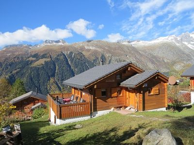 Photo for 5 star chalet with stunning views, top location, free Wi-Fi, ski-in-ski-out