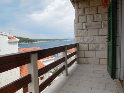 Photo for Two bedroom apartment with balcony and sea view Povlja, Brač (A-14367-a)