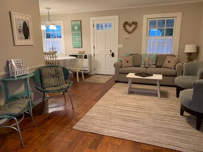 Living room, showing the front Dutch door, with the dining area to the left.