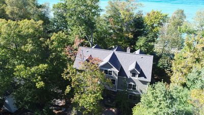An aerial view of our 3 story house showing proximity to the beach...very close!
