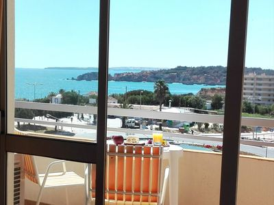 Photo for Sunny Apartment at Praia da Rocha (wifi + cable + ac)
