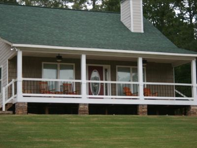 Watch the family play in the lake as you enjoy the shaded porch