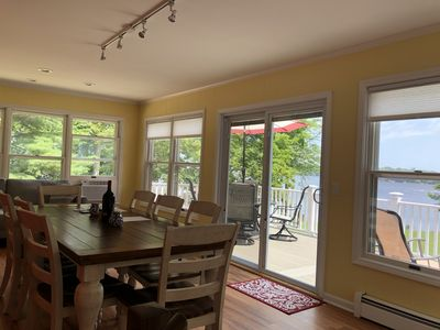 Lovely, bright sunroom with access to deck and breathtaking view of lake