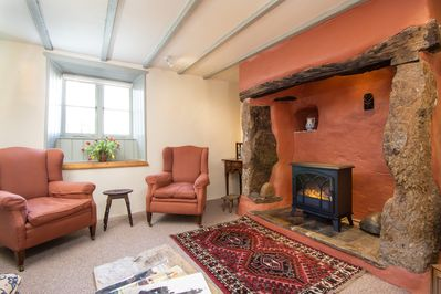 Comfortable sitting room with original hearth