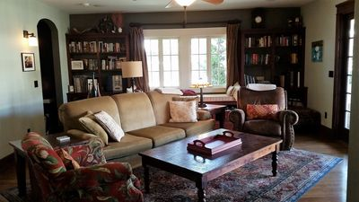 Family Room with window seat,  large HDTV, blu-ray DVD, opens to pool area.