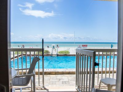 Photo for NEW LISTING! BEACHFRONT GROUND FLOOR CONDO! STEPS FROM POOL AND BEACH!.