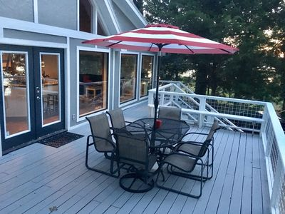 Take in the sunset from the large deck with patio table and Weber grill.