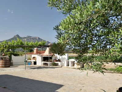 Photo for Holiday Apartment in a Quiet Location, Close to the Beach with Terrace, Garden & Wi-Fi; Parking Available