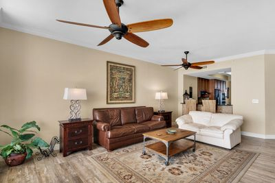 Spacious Family Room With Nice Leather Seating, Great Ceiling Fans, and More
