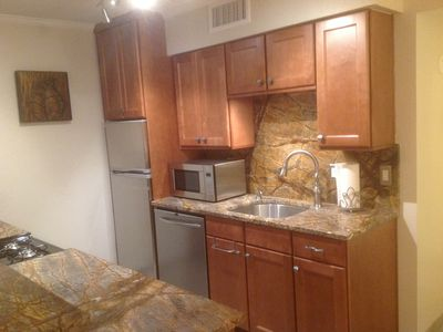 Photo for DOWNTOWN Austin condo, 6th St. A few blocks to Congress. Great SXSW location!