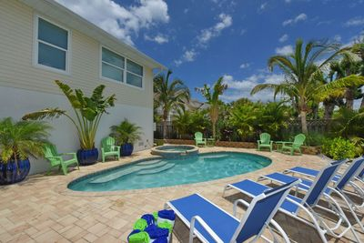 Enjoy the tranquility in the backyard and the tropical heated pool/ spa/ canal