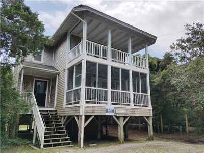 Photo for Speckled Trout:  Southern coastal style cottage, enjoy the porches.