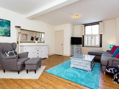 Photo for Only 20 minutes to Oxford Circus! Sleek 4 bedroom home in Kensington (Veeve)