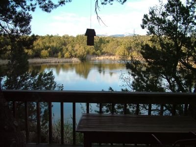 view of the private lake and the La Plata Mountains from the Lake House deck