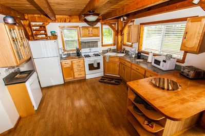Kitchen with spacious counters and amenities.