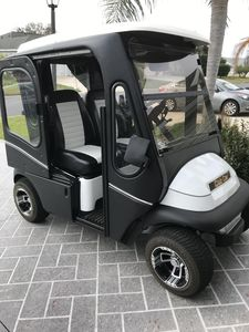 New electric club car with sleek line doors, great for those cool mornings