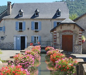 Photo for The Moulin d'Arudy ***: historic house on the canal and its wash-houses