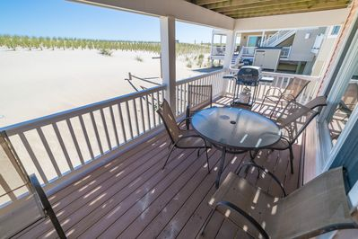 Enjoy a barbecue on your private deck or relax while the kids play in the sand