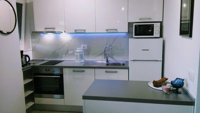 modern kitchen with sea view from window