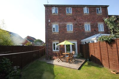 Back garden with patio set and private garden