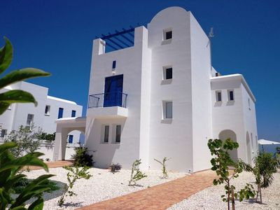 Photo for This brand new, luxurious villa in prime seafront location. Beautifully furnished, this fabulous bea